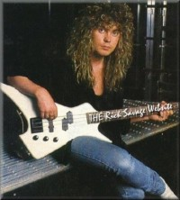 photo-Rick-Savage-bassist-guitar-Def-Leppard-musician